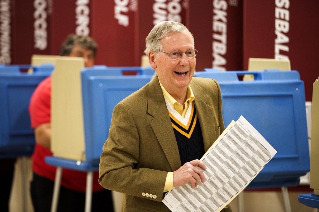 . Senate Minority Leader U.S. Sen. Mitch McConnell (R-KY) holds his ballot after voting in the midterm elections at Bellarmine University November 4, 2014 in Louisville, Kentucky. McConnell is running in a tight race against opponent Kentucky Secretary of State Alison Lundergan Grimes. (Photo by Aaron P. Bernstein/Getty Images)