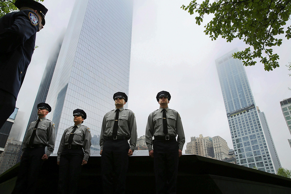 . Port Authority of New York and New Jersey police cadets pause at the Ground Zero memorial site during the dedication ceremony of the National September 11 Memorial Museum in New York, Thursday, May 15, 2014.  (AP Photo/Spencer Platt, Pool)
