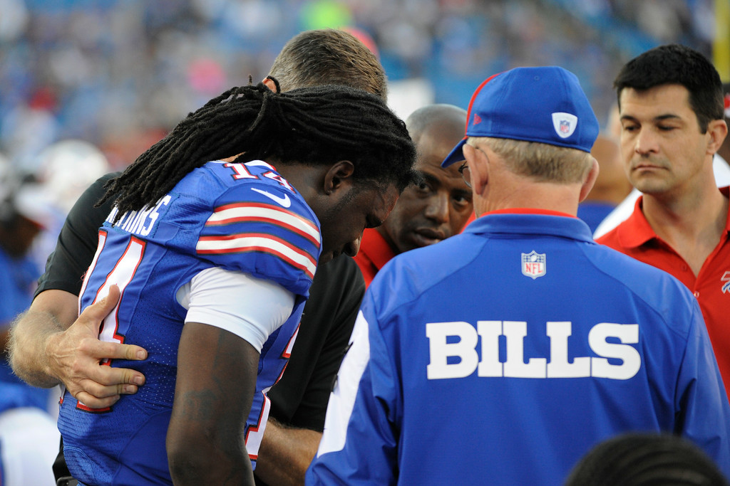 . Buffalo Bills wide receiver Sammy Watkins (14) talks to medical staff during the first half of a preseason NFL football game against the Detroit Lions, Thursday, Aug. 28, 2014, in Orchard Park, N.Y. (AP Photo/Gary Wiepert)