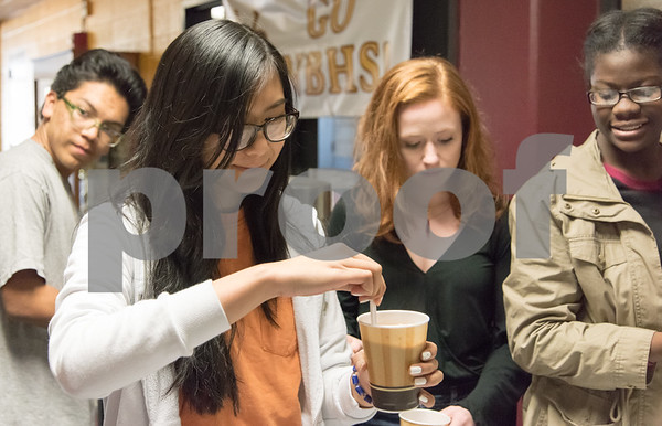 12/06/17 Wesley Bunnell   Staff Joann Khambaylarsirkul from the New Britain High School Interact Club sells hot chocolate with other club members after school in a fundraiser for Warm the Children on Wednesday October 29th.