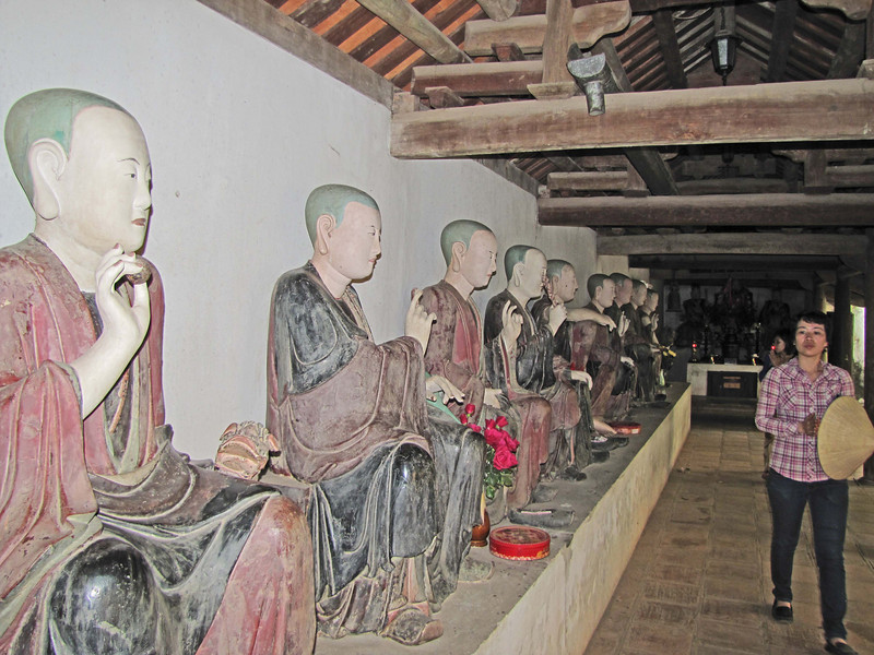 41-Seated monks line the path to the shrine.
