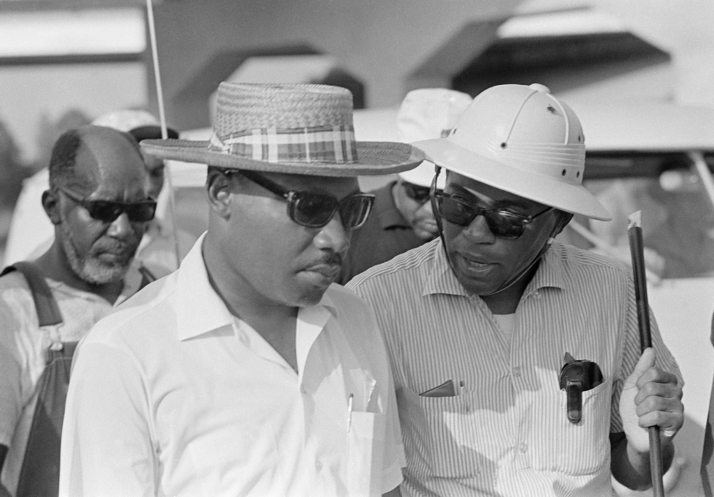 . James Meredith, right, chats with Dr. Martin Luther King after they met on U.S. 51 near Tougaloo, Mississippi on June 25, 1966. Dr. King had led a column of civil rights marchers from Tougaloo College to greet Meredith?s marchers walking in from Canton. (AP Photo)