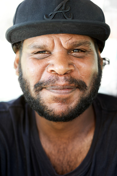 Indigenous Australian young man with a cap