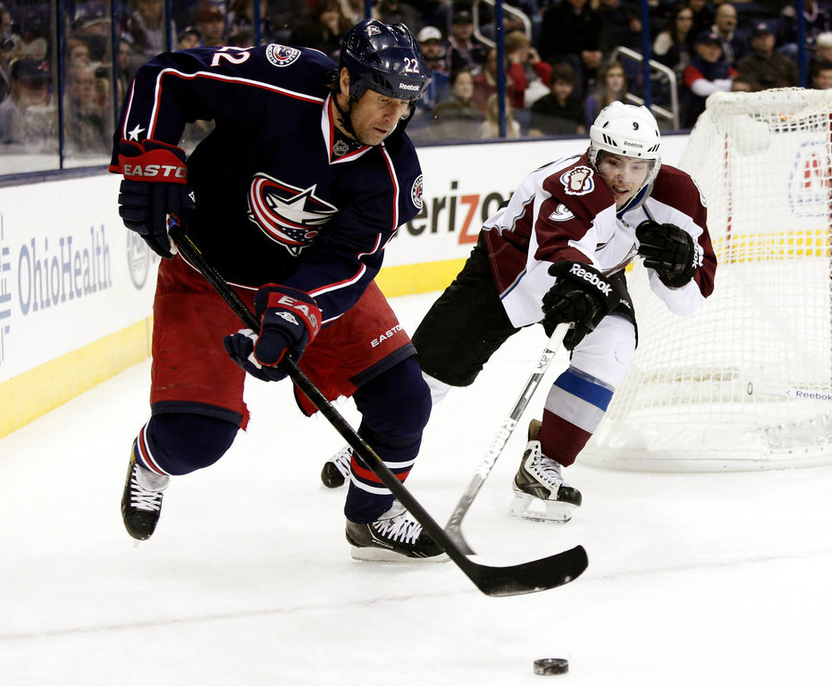 . Columbus Blue Jackets\' Vinny Prospal, left, of the Czech Republic, works for the puck against Colorado Avalanche\'s Matt Duchene in the second period of an NHL hockey game in Columbus, Ohio, Sunday, March 3, 2013. The Blue Jackets won 2-1. (AP Photo/Paul Vernon)