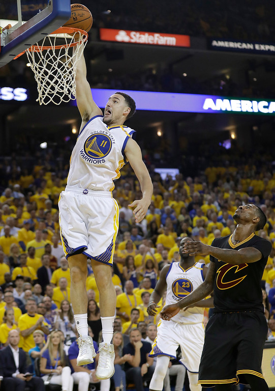 . Golden State Warriors guard Klay Thompson (11) dunks against the Cleveland Cavaliers during the first half of Game 2 of basketball\'s NBA Finals in Oakland, Calif., Sunday, June 4, 2017. (AP Photo/Marcio Jose Sanchez)
