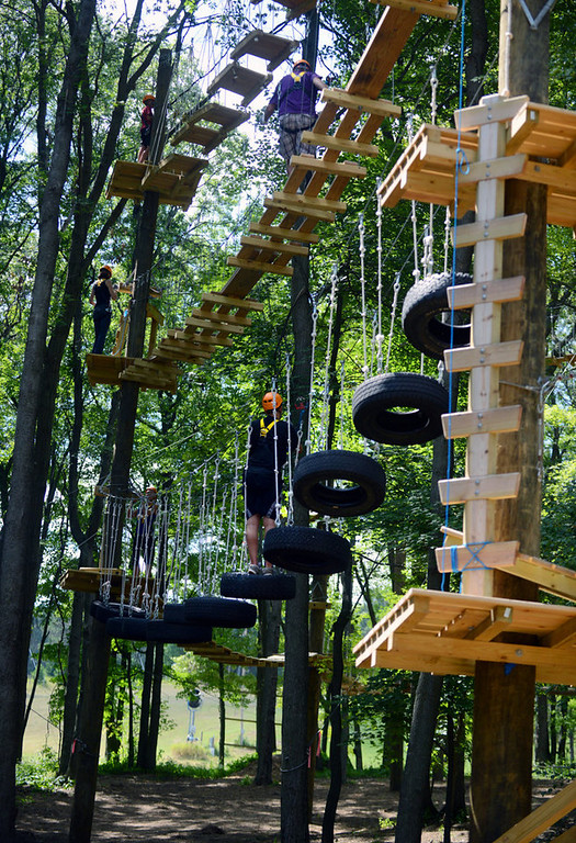 . Guests at play on the challenge course at the Aerial Adventure Park at Trollhaugen. (Pioneer Press: Chris Polydoroff)
