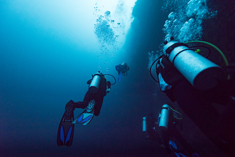 Scuba divers underwater, The Great Blue Hole, Belize Barrier Reef, Lighthouse Reef, Belize