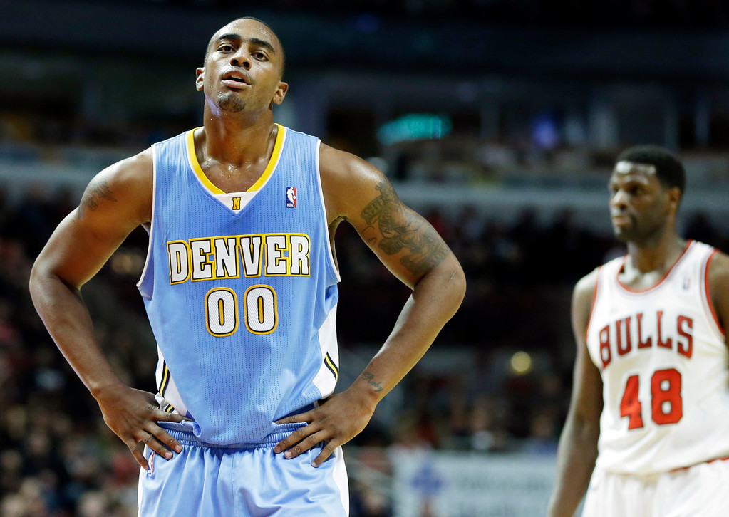 . Denver Nuggets forward Darrell Arthur (00) reacts after Chicago Bulls forward Luol Deng gets a free-throw during the second half of an NBA preseason basketball game in Chicago on Friday, Oct. 25, 2013. The Bulls won 94-89. (AP Photo/Nam Y. Huh)