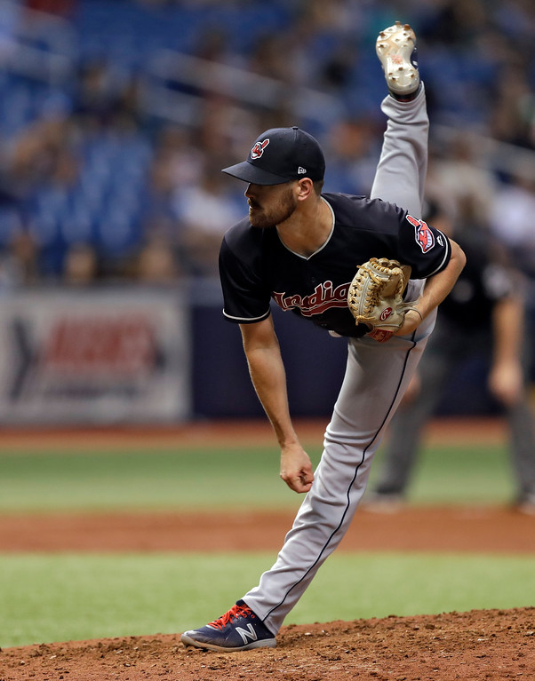 . Cleveland Indians\' Shane Bieber follows through on a pitch to Tampa Bay Rays\' C.J. Cron during the sixth inning of a baseball game, Tuesday, Sept. 11, 2018, in St. Petersburg, Fla. (AP Photo/Chris O\'Meara)