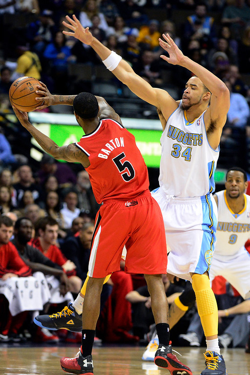 . DENVER, CO - APRIL 14: JaVale McGee (34) of the Denver Nuggets defends Will Barton (5) of the Portland Trail Blazers during the first half of action. The Denver Nuggets play the Portland Trail Blazers at the Pepsi Center. (Photo by AAron Ontiveroz/The Denver Post)