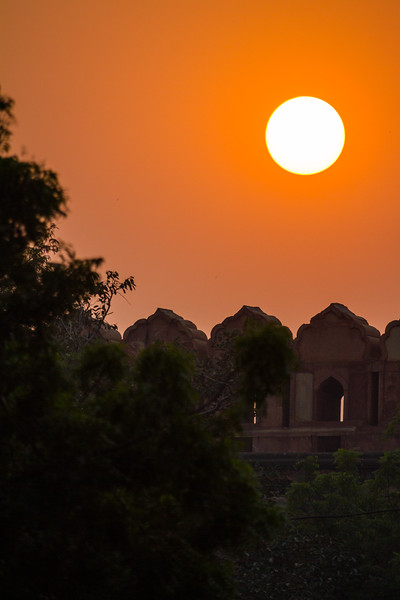 The sun sets over structures in India