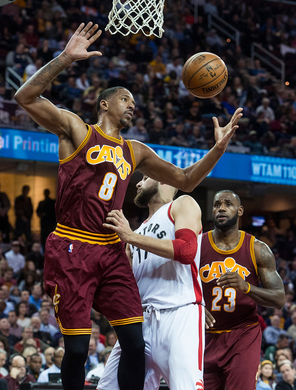 . Cleveland Cavaliers\' Channing Frye (8) grabs a rebound in front of Toronto Raptors\' Jonas Valanciunas (17) as Cavaliers\' LeBron James (23) watches during the first half of an NBA basketball game in Cleveland, Tuesday, Nov. 15, 2016. (AP Photo/Phil Long)