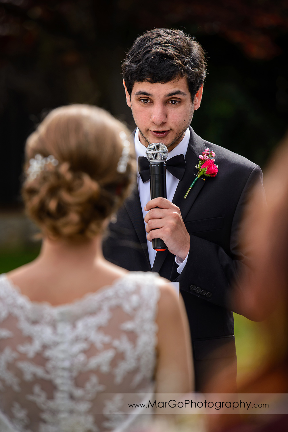 groom saying vows during wedding ceremony at Fremont Century House & Gardens