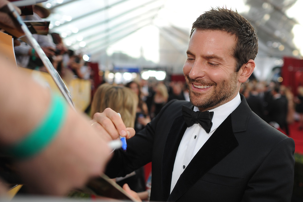 . Bradley Cooper signs autographs on the red carpet at the 20th Annual Screen Actors Guild Awards  at the Shrine Auditorium in Los Angeles, California on Saturday January 18, 2014 (Photo by Hans Gutknecht / Los Angeles Daily News)