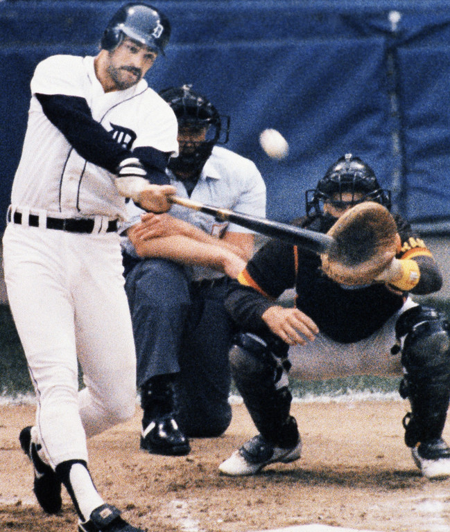. Kirk Gibson belts a two-run homer to give the Detroit Tigers a lead in the first inning of World Series game at Tiger Stadium in Detroit Sunday, Oct. 14, 1984.   San Diego catcher is Terry Kennedy; umpire is Paul Runge. (AP Photo/Ron Heflin)