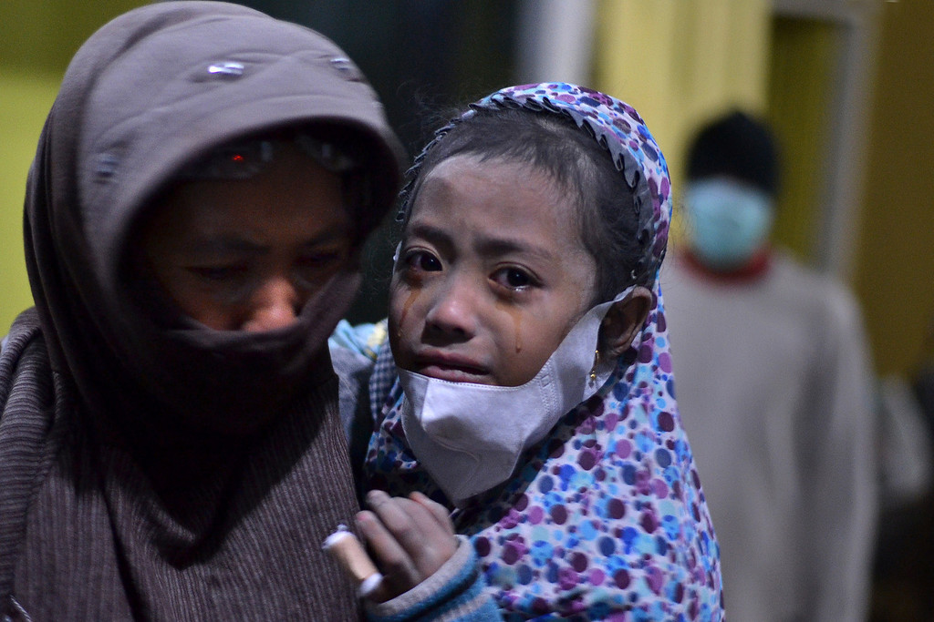 . A child cries in the evacuation center in Malang district during the eruption of Mount Kelud volcano in East Java province on February 14, 2014.  AFP PHOTO / AMAN ROCHMAN/AFP/Getty Images
