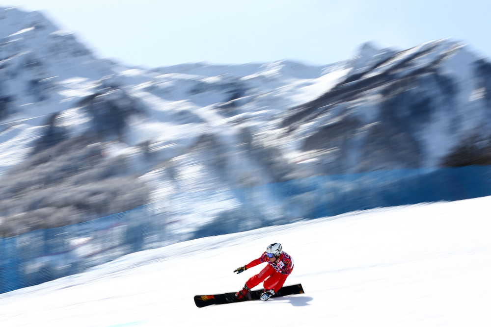 . Nevin Galmarini of Switzerland competes in the Snowboard Men\'s Parallel Giant Slalom Quarterfinals on day twelve of the 2014 Winter Olympics at Rosa Khutor Extreme Park on February 19, 2014 in Sochi, Russia.  (Photo by Cameron Spencer/Getty Images)