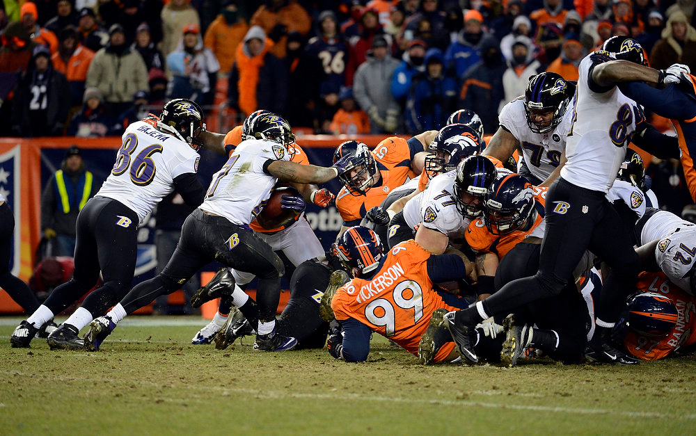Description of . Baltimore Ravens running back Ray Rice (27) runs the ball in for a touchdown resulting in a 28 to 28 tie.  The Denver Broncos vs Baltimore Ravens AFC Divisional playoff game at Sports Authority Field Saturday January 12, 2013. (Photo by Tim Rasmussen,/The Denver Post)