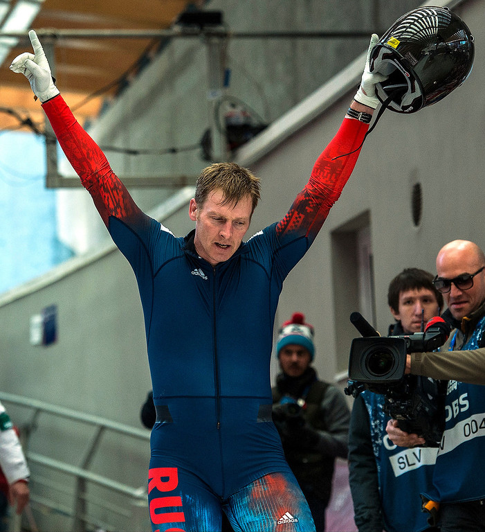 . Russian\'s Alexander Zubkov celebrates after winning during the four-man bobsled competition at Sanki Sliding Center during the 2014 Sochi Olympics Sunday February 23, 2014. Team Russia won the gold medal with a cumulative time of 3:40.60. (Photo by Chris Detrick/The Salt Lake Tribune)