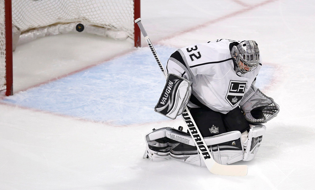 . Los Angeles Kings goalie Jonathan Quick lets in a goal by Chicago Blackhawks\' Duncan Keith (not pictured) during the first period in Game 5 of their NHL Western Conference final hockey playoff series in Chicago, Illinois, June 8, 2013. REUTERS/Jim Young