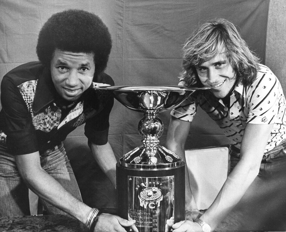 . Tennis stars Arthur Ashe, left, and Bjorn Borg pose in Dallas with the World Championship of Tennis Trophy, May 10, 1975. They will meet on the court at noon on Sunday for the title with the winner getting $50,000 first prize money. (AP Photo)