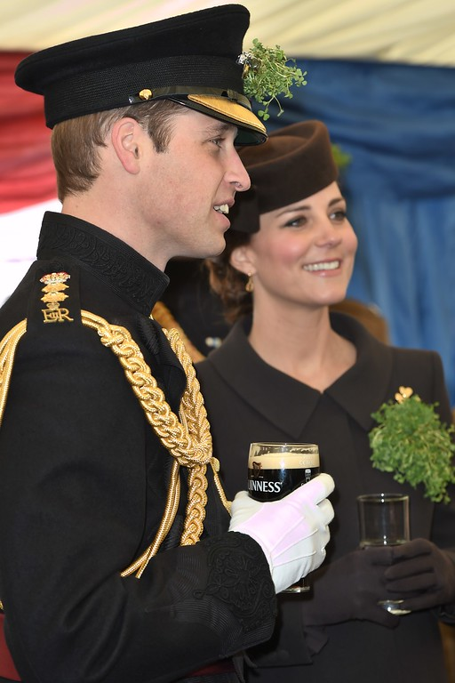 . Britain\'s William, the Duke of Cambridge (L) and his wife Britain\'s Catherine, Duchess of Cambridge, (R) are pictured during a visit of the Irish Guards during a St Patrick\'s Day parade in Mons Barracks in Aldershot, west of London, on March 17, 2015. Prince William attended the parade as Colonel of the Regiment and Britain\'s Catherine presented the traditional sprigs of shamrocks to the officers and guardsmen of the regiment.  AFP PHOTO / POOL / EDDIE  MULHOLLAND/AFP/Getty Images
