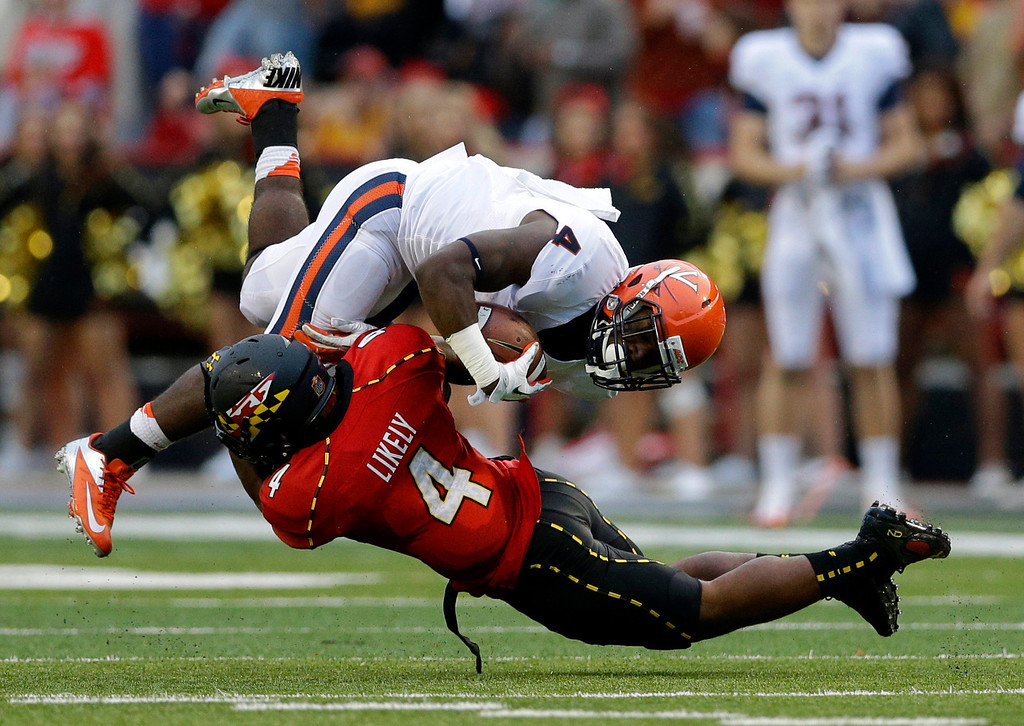 . Virginia running back Taquan Mizzell, top, is stopped by Maryland defensive back William Likely in the second half of an NCAA college football game in College Park, Md., Saturday, Oct. 12, 2013. Maryland won 27-26. (AP Photo/Patrick Semansky)