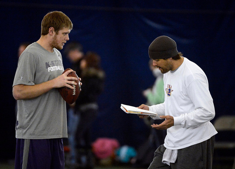 . Former Denver Broncos quarterback, Jake Plummer, right, goes over notes with former Kansas State star quarterback, Collin Klein, left, inside the South Suburban Parks and Recreation\'s Sport Dome in Centennial, Colorado, Thursday morning, February 14th, 2013.  Plummer has spent weeks with Klein preparing him for the upcoming NFL Scouting Combine in Indianapolis, Indiana February 20th thru February 26th 2013. (Photo By Andy Cross / The Denver Post)