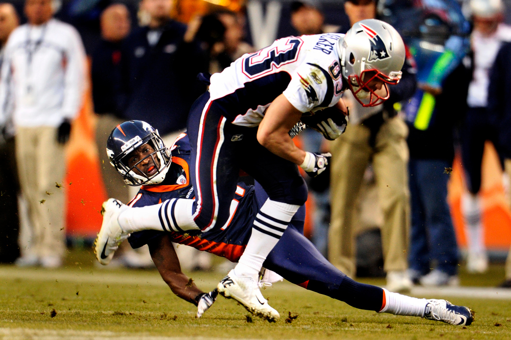 . Denver Broncos cornerback Andre\' Goodman #21 misses a tackle on a first down catch and run from New England Patriots wide receiver Wes Welker #83 during a scoring drive that will make the score 34-16 at Sports Authority Field at Mile High,  Denver, Sunday, December 18, 2011.   Joe Amon, The Denver Post