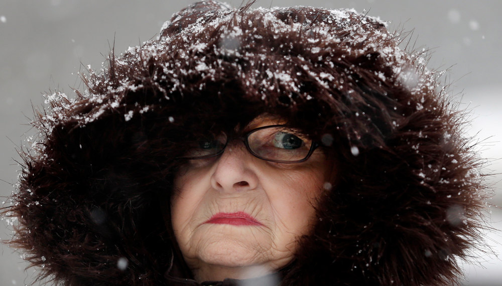 . Mary Ann Bova walks along a slippery snow covered sidewalk during a winter storm in Buffalo, N.Y., Friday, Feb. 8, 2013. In some upstate areas, snow fell early Friday morning and was expected to increase throughout the day, with the heaviest accumulations expected in eastern New York on Friday night.(AP Photo/David Duprey)