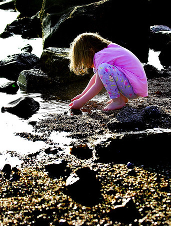 As the set sets a little girl explores the wonders of where the Pacific meets California.