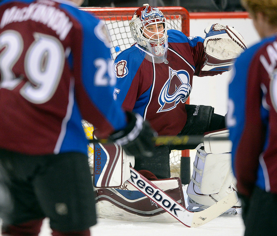 . Colorado goalie Jean-Sebastien Giguere was in goal during warmups Wednesday night.  The Colorado Avalanche hosted the Chicago Blackhawks at the Pepsi Center Wednesday night, March 12, 2014 in Denver, Colorado. (Photo by Karl Gehring/The Denver Post)