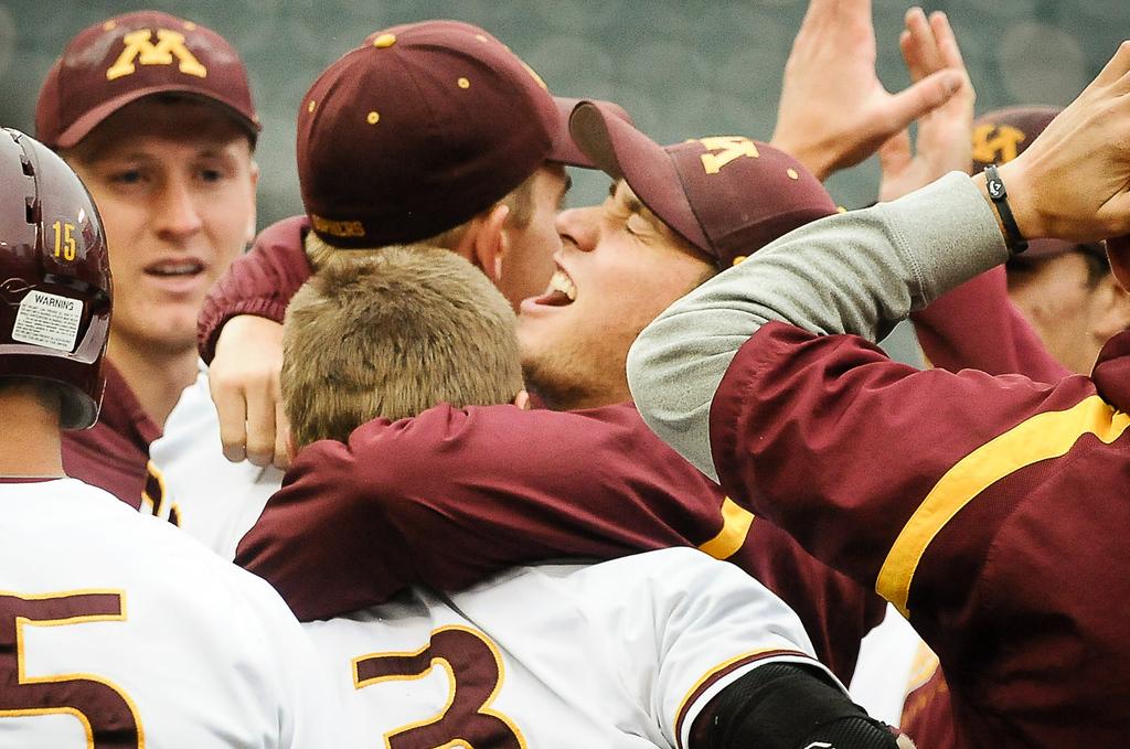 . Minnesota players celebrate their victory.  (Pioneer Press: Ben Garvin)
