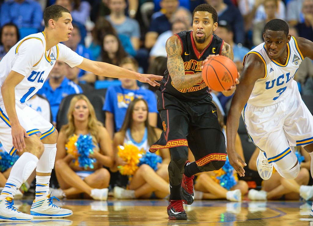 . USC�s J.T. Terrell looks for a rout out as UCLA�s Jordan Adams and Zach LaVine defend on the play during game action at Pauley Pavilion Sunday, December 5, 2014. UCLA  defeated USC 107-73.  Photo by David Crane/Los Angeles Daily News.