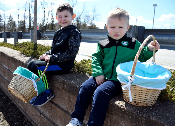 3/24/2018 Mike Orazzi | Staff Brothers Pierce and Charlie Downes,5 and 3, while at the annual Terryville Lions Club Easter Egg Hunt held at Terryville High School Saturday.
