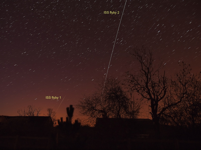 Early hours of April 9th 2011. The International Space Station (ISS) passes over UK skies, not once but twice, in a double flyby. The first flyby at 0308hrs & second just over an hour later at 0439hrs. There was actually a third flyby at 0613hrs but daylight prevented the camera from capturing. Both flybys were captured separately and flattened with software to produce the final composite image. What you are viewing here is the sun's reflection as the ISS passes over. The shorter flyby 1 is down to the ISS being hidden in most part by the Earth's shadow and therefore invisible.