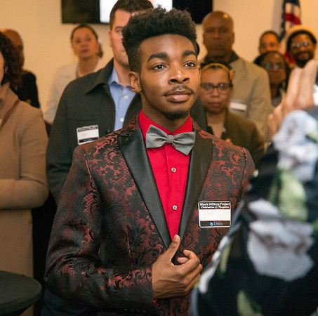 02/28/20 Wesley Bunnell | Staff Twenty five men were honored at Gallery 66 on Friday night for their involvement in the community as part of Black History Month. A visitor listens intently as John &quote;Tang-Sauce&quote; Manselle-Young, addressed everyone.