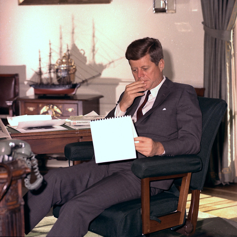. FILE - In this Jan. 18, 1962 file photo, U.S. President John F. Kennedy looks over notes at his desk in the White House. (AP Photo/Henry Burroughs)