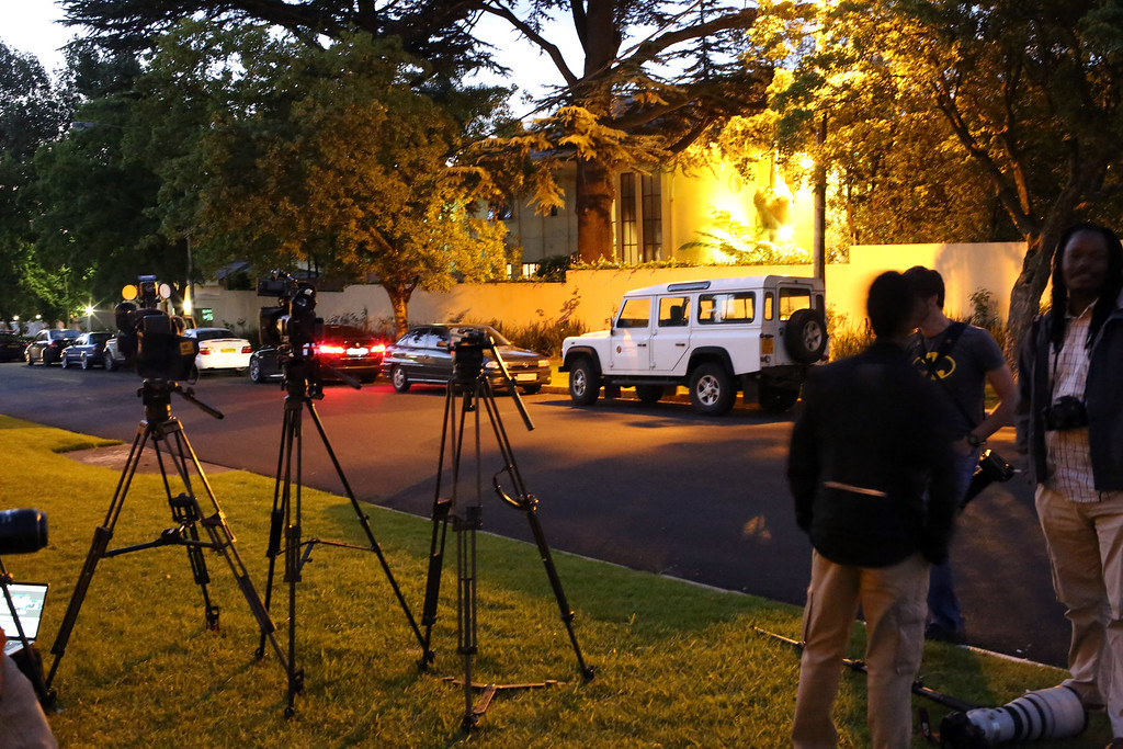 . Media wait for news outside  Nelson Mandela\'s home in Johannesburg on December 6,2013 .  Mandela, the revered icon of the anti-apartheid struggle in South Africa and one of the towering political figures of the 20th century, has died aged 95, President Jacob Zuma said on December 6. (ALEXANDER JOE/AFP/Getty Images)