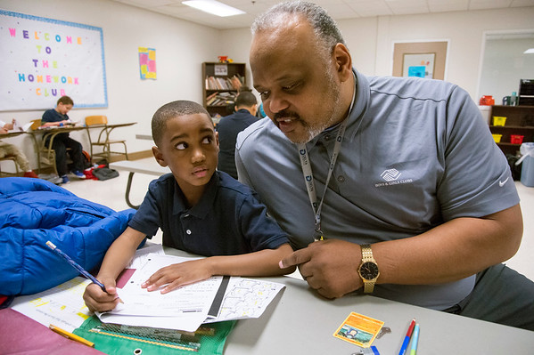 02/18/20 Wesley Bunnell | StaffrrAllan Maddox, age 6, receives help from Berwyn Kelley, the Senior Program Director of the New Britain Boys and Girls Club during a home work club session on Tuesday afternoon.