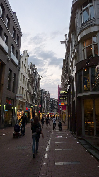 "Spui (pronounced ""spow""). An upscale shopping street."