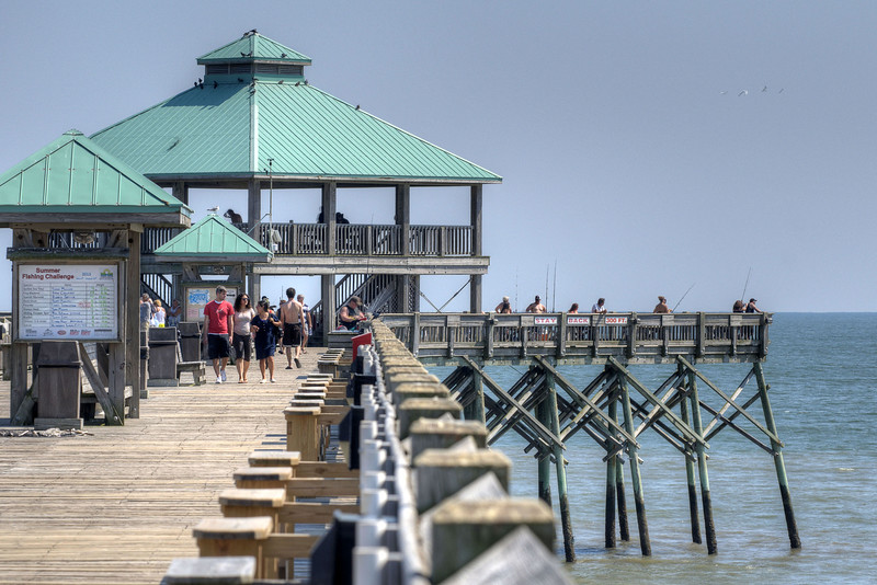 People fish off the end of the Edwin S. Taylor Fishing Pier in Folly Beach, SC on Sunday, September 8, 2013. Copyright 2013 Jason Barnette