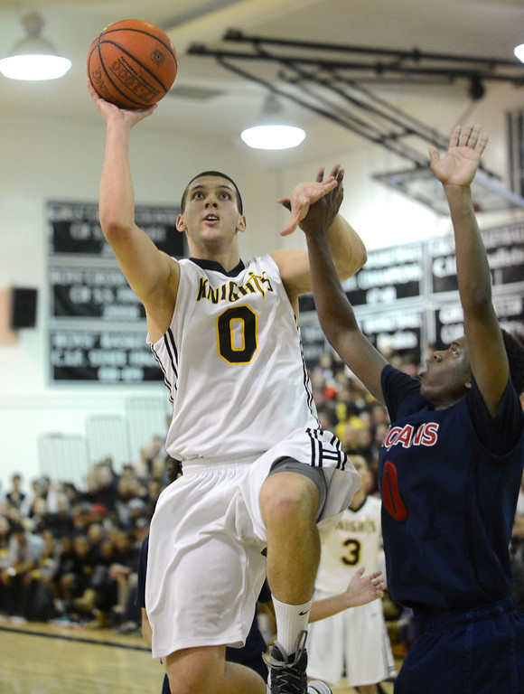 . Bishop Montgomery\'s Ognjen Miljkovic (0) puts up a shot over La Verne Lutheran\'s Skyler Williams (0) in a CIF SS Division IV-AA semifinal game in Torrance Friday night. Lutheran stunned Bishop Montgomery 63-59, ending their unbeaten season. 20130222 Photo by Steve McCrank / Staff Photographer