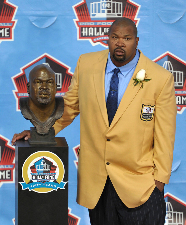 . Hall of Fame inductee Larry Allen poses with his bust during the 2013 Pro Football Hall of Fame Induction Ceremony Saturday, Aug. 3, 2013, in Canton, Ohio. (AP Photo/David Richard)