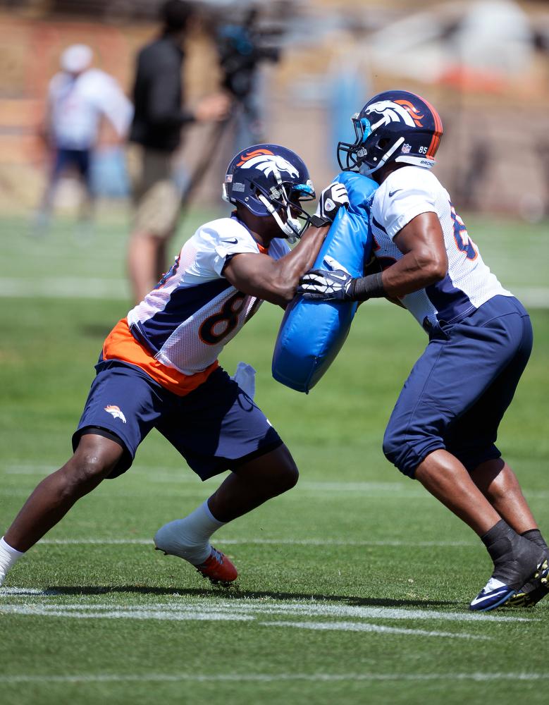 . Denver Broncos Gerrell Robinson (89) runs through drills with Virgil Green (85) during OTAs June 12, 2014 at Dove Valley. (Photo by John Leyba/The Denver Post)