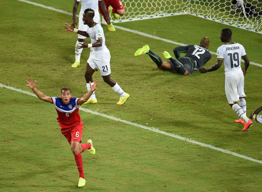 . US defender John Brooks (L) celebrates after scoring during a Group G football match between Ghana and US at the Dunas Arena in Natal during the 2014 FIFA World Cup on June 16, 2014.    JAVIER SORIANO/AFP/Getty Images
