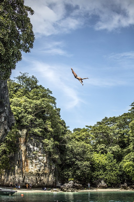 . In this handout image provided by Red Bull, Artem Silchenko of Russia dives from the 27 meter platform at training on Hong Island in the Andaman Sea during the final stop of the 2013 Red Bull Cliff Diving World Series on October 25, 2013 at Krabi, Thailand. (Photo by Romina Amato/Red Bull via Getty Images)