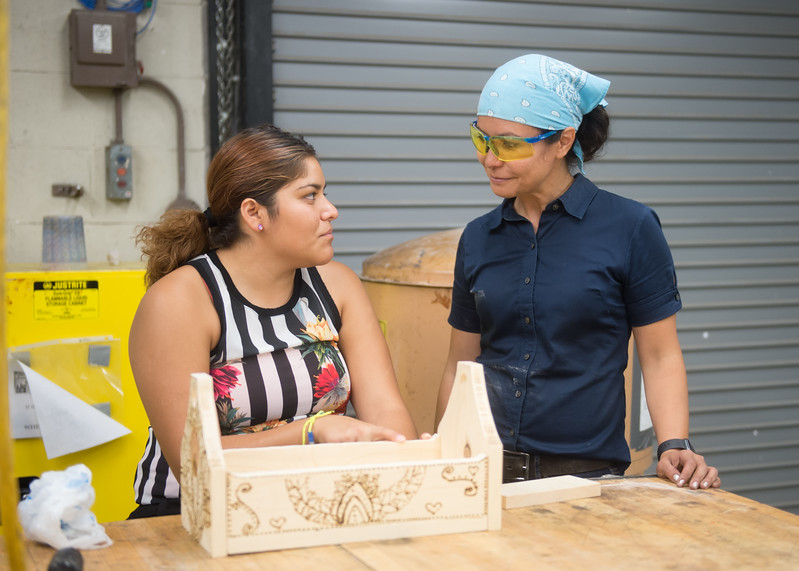 Student Samantha Sandoval asks Professor Leticia Bajuyo for advice on how to proceed with her project during Sculpture I.