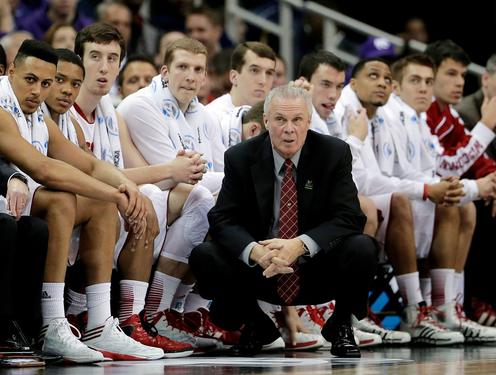 . Wisconsin coach Bo Ryan and his bench watch the final moments of the second half against Mississppi in a second-round game at the NCAA college basketball tournament Friday, March 22, 2013, in Kansas City, Mo. Mississippi won 57-46. (AP Photo/Charlie Riedel)