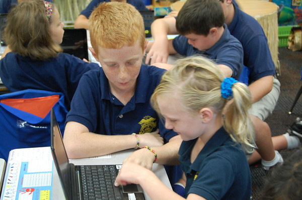 1st Grade Gets Help From 5th Grade on Computers